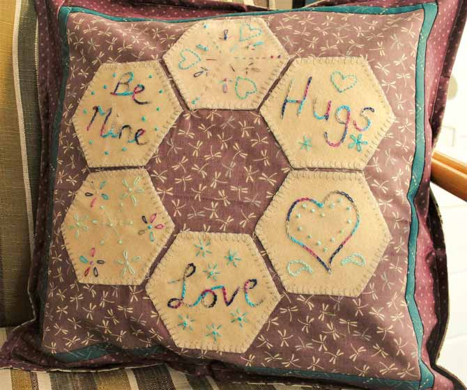 Here's the finished cushion with the appliqued and embroidered hexagons