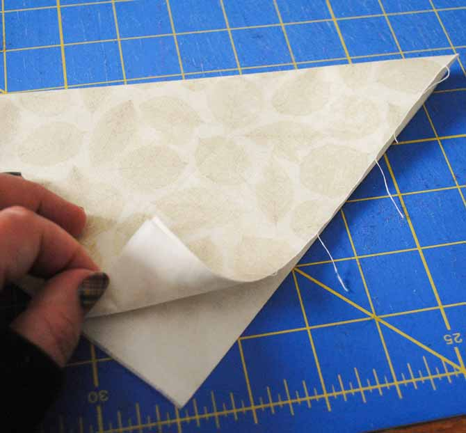Iron the fusible interfacing to the back of the fabric and then fold the two in half diagonally and press