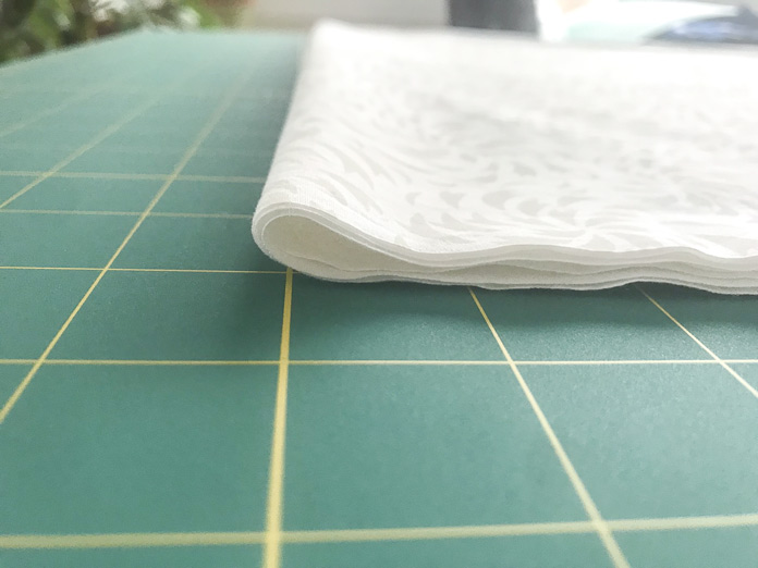 Folding a piece of fabric onto itself with make it easier to cut long strip of fabric. A TrueCut tutorial on how to use the TrueCut System including: TrueCut My Perfect Rotary Cutter, TrueCut 360º circle cutter, TrueCut Rulers and TrueCut Grips