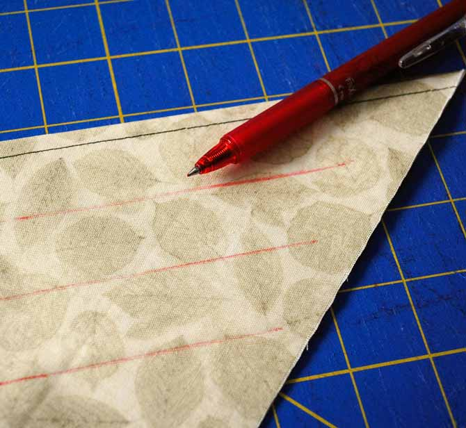 Topstitch along the folded edge and then use an erasable pen to draw lines parallel to the fold