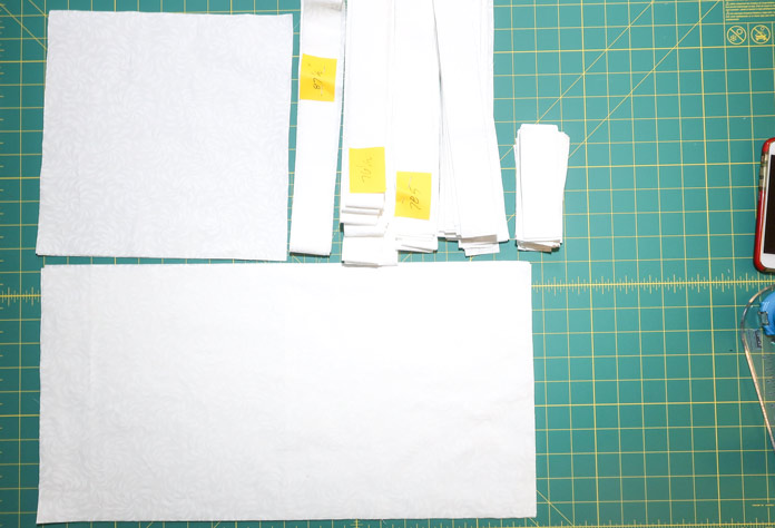 Keep your cut fabrics separated in individual piles and identify the length of the strips.