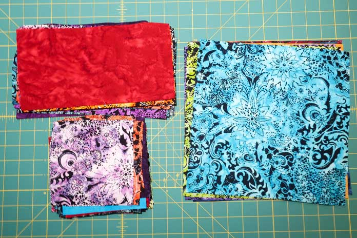 The square and rectangle pieces of fabrics needed for the quilt.