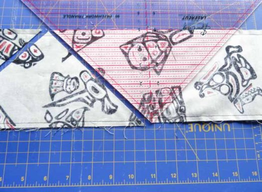 "Rotate the ruler and align the 5"" line with the other edge of the fabric."