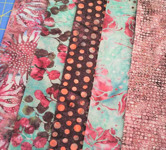 The five rose colored strips picked to make the blocks