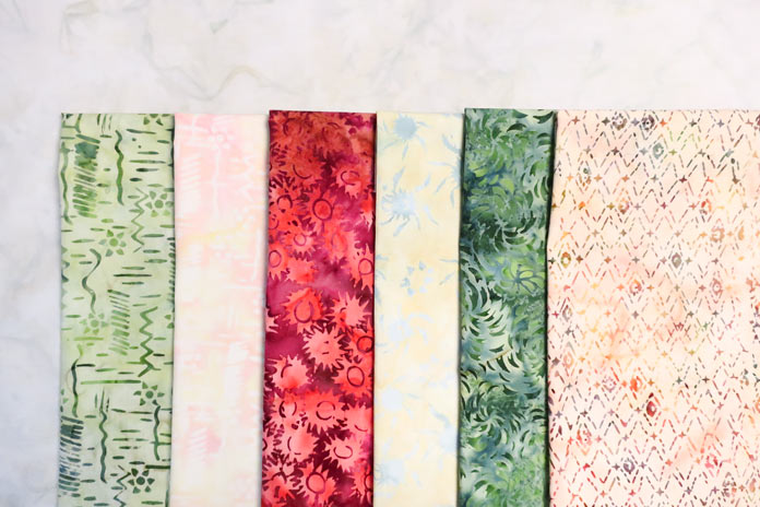 6 fabrics from the Primitive Lines collection that will be used in the quilt.