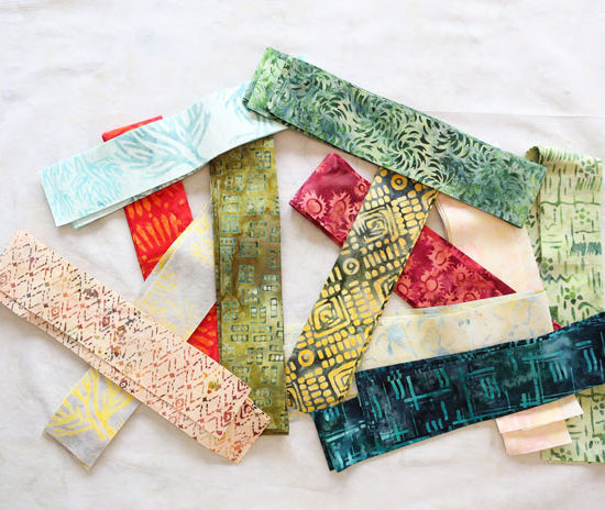 "2¼"" fabric strip ready to be cut and sewn."