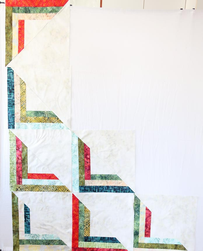 Quilt blocks layout on design wall.