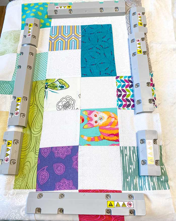 A quilt sandwich shown in the magnetic frame