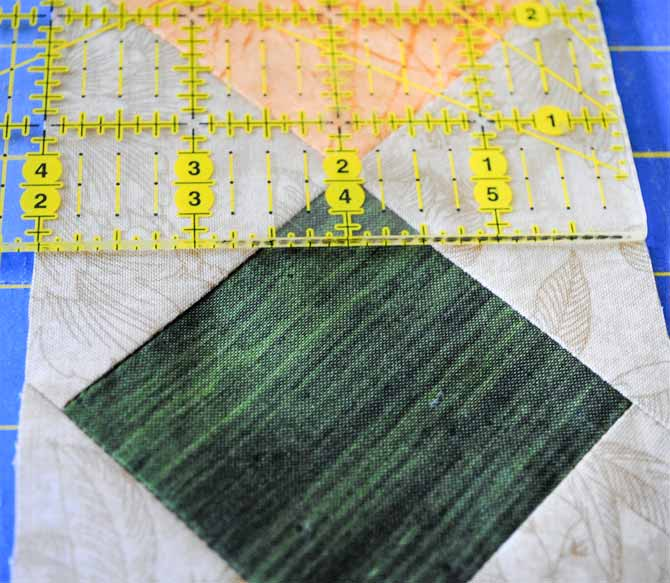 This photo shows the rotary cutting ruler measuring the pieced border after it has been trimmed.