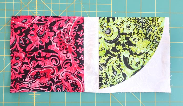 "Once a 1½"" x 5"" strip is sewn to a 5"" x 5"" quarter circle or square, sew another 5"" x 5"" piece."