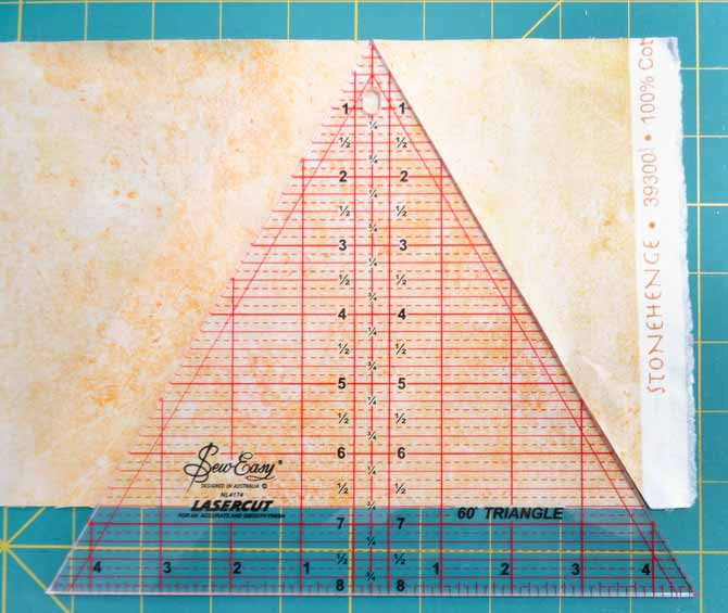"Sew Easy triangle is use to cut triangles from 6¾"" wide strips."