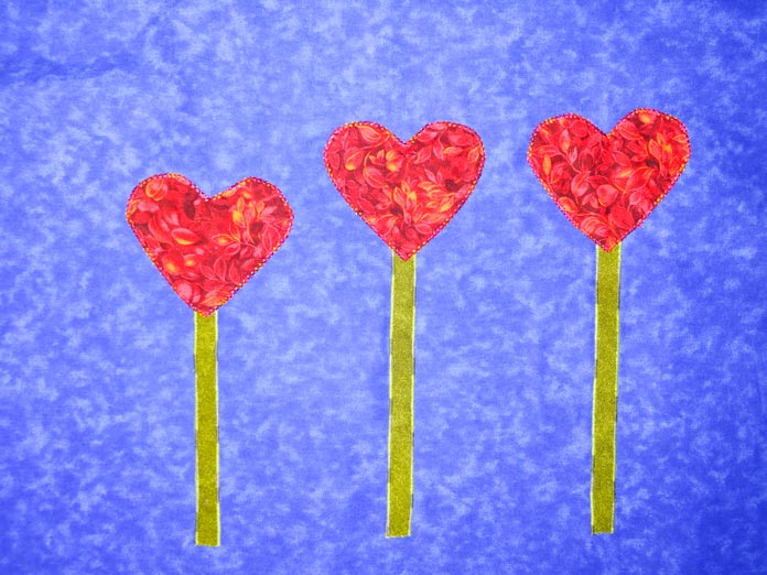 Hearts appliqued to the top of the stems