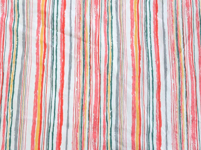 How striped fabric for binding adds interest to Boho Beach picnic quilt