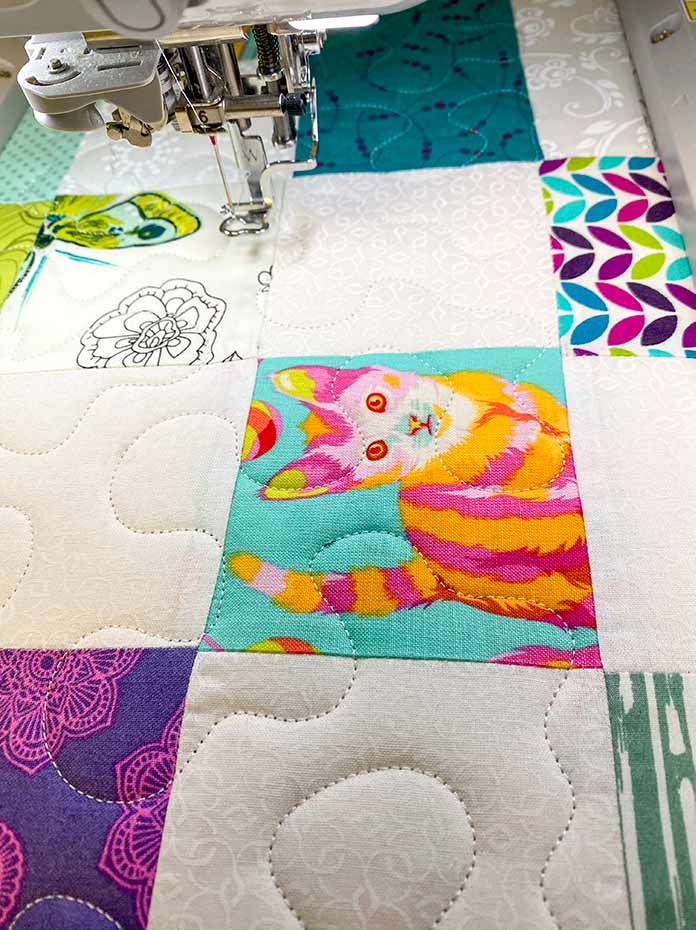 Stipple quilting on a quilt using the Brother Luminaire 2 Innov-ìs XP2 and the Magnetic Sash Frame.