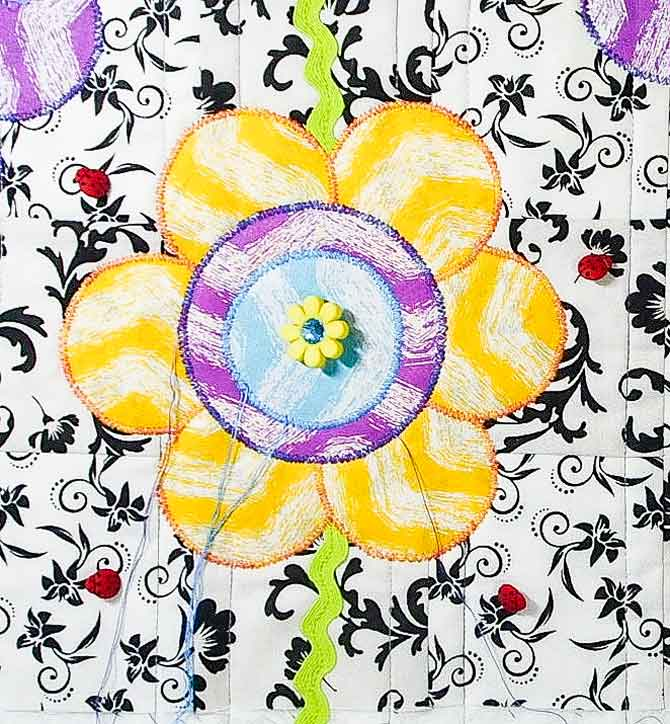 Free motion satin stitch around flower