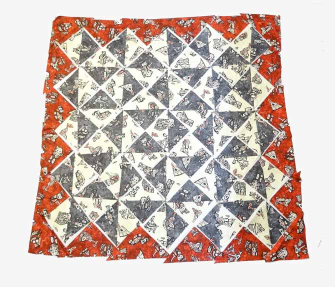 Placement of the quilt block and triangles