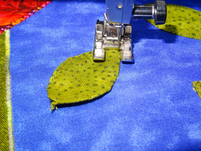 WonderFil InvisaFil being used to secure an applique leaf.