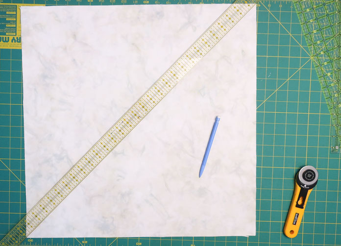 Draw a diagonal line on the 4 pieces of the background fabric.