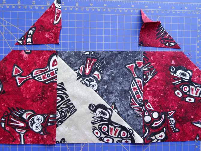 Cut off the dog ears after the rows are sewn.