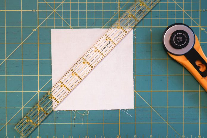 Cut the squares into 2 halves by cutting along diagonal line.