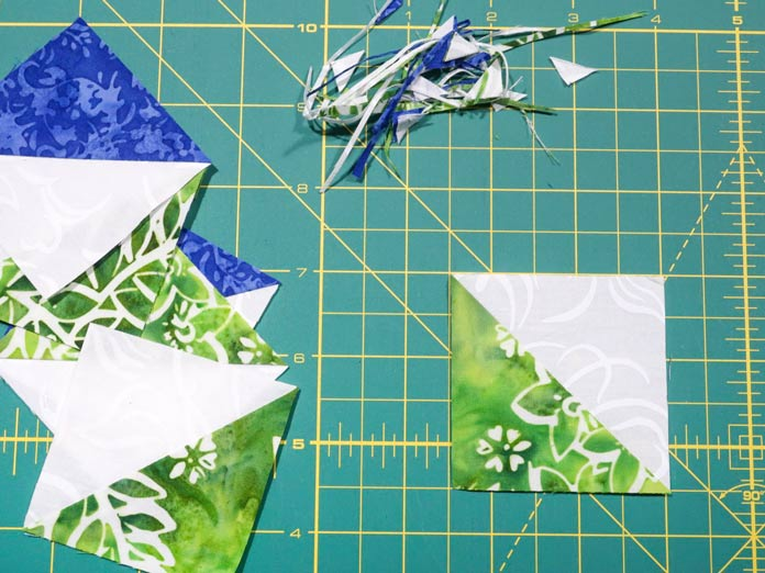 """Trim your Half Triangle Squares down to 2½"""" x 2½"""", if required."""