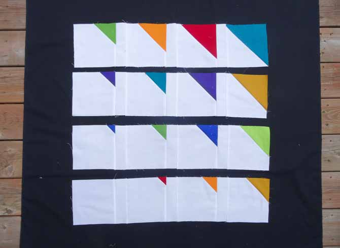 "The 2"" x 6½"" white strips are sewn between each block."