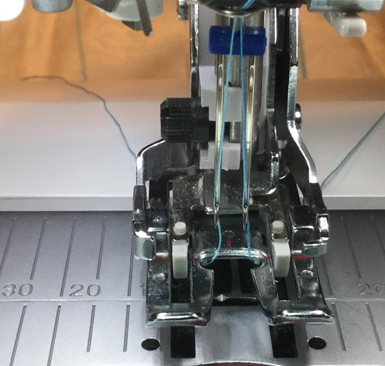 A 4.0/100 Jeans/Denim needle is on my machine, threaded and ready for straight line quilting. SCHMETZ twin needle