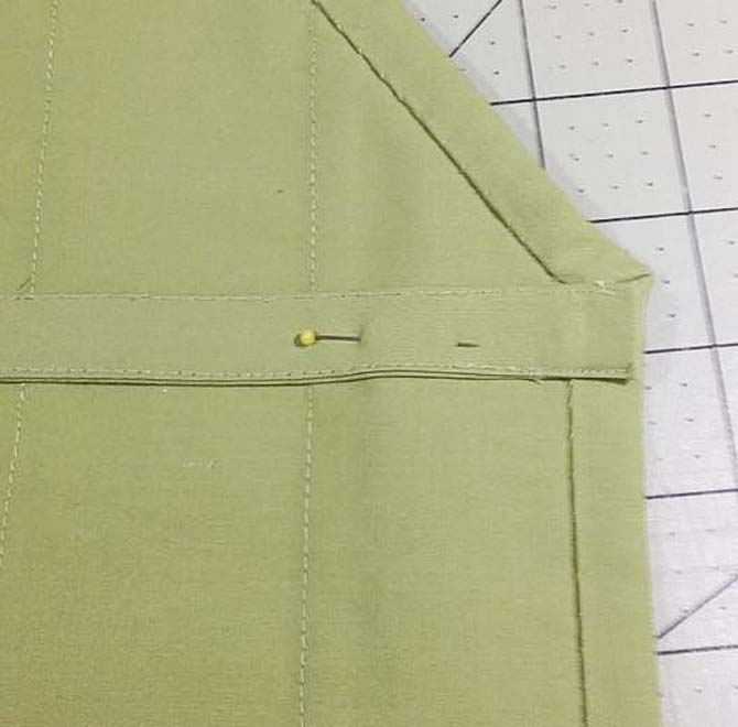 "One of the 20"" long straps is pinned to the side edge of the apron made with Northcott's Urban Elementz Basix fabrics."