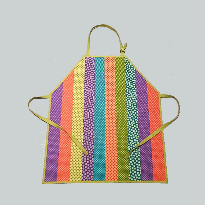 The finished Little Artist Apron made with Urban Elementz Basix fabrics from Northcott.