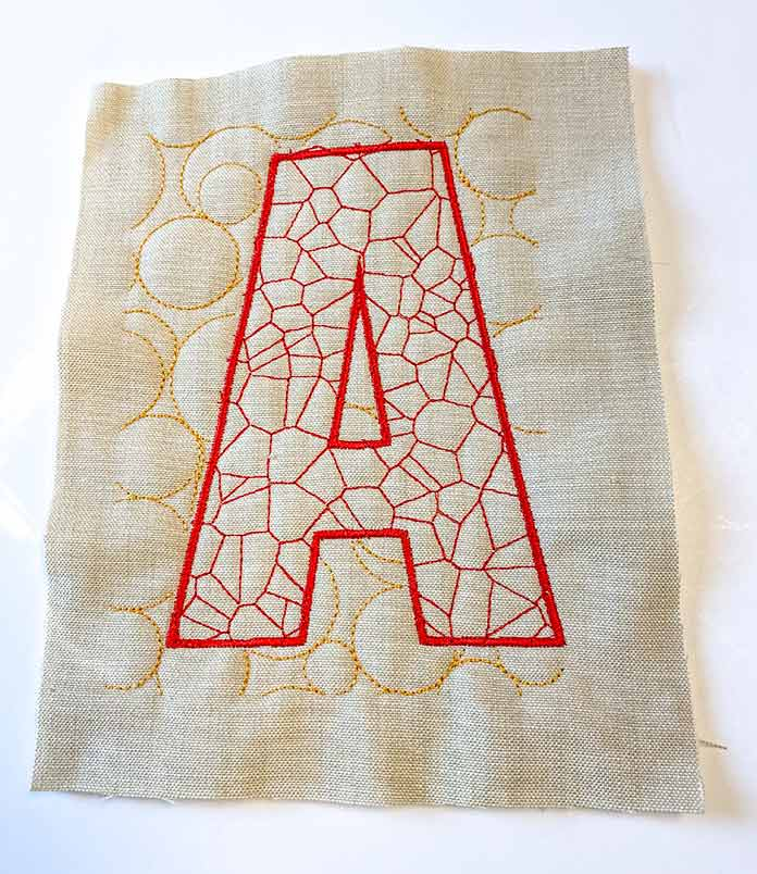 An embroidered letter A quilt block using the QuiltBroidery feature on the Brother Luminaire 2 Innov-ìs XP2