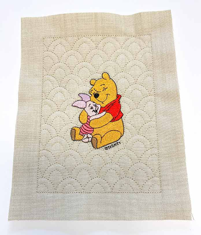 Embroidered and trimmed Winnie the Pooh Quilt Block