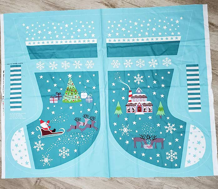 A Christmas stocking panel in teal and cream