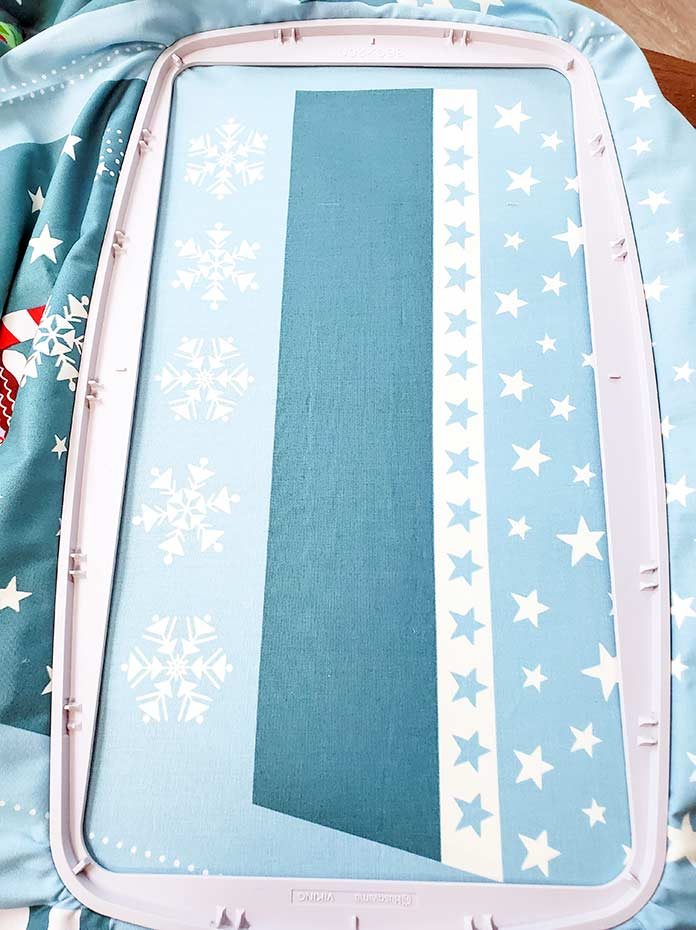 A teal-colored Christmas stocking panel in the Husqvarna Viking DESIGNER Royal Hoop