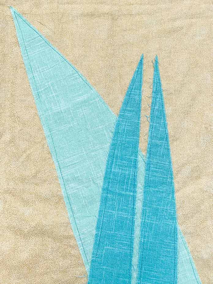 Hoffman 24/7: Linen fabrics in Aqua and Mint to create improv leaves on a quilt