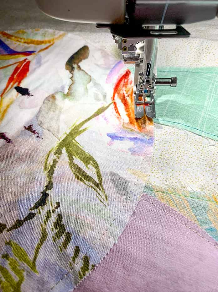Using a walking foot on a sewing machine to applique fabric pieces