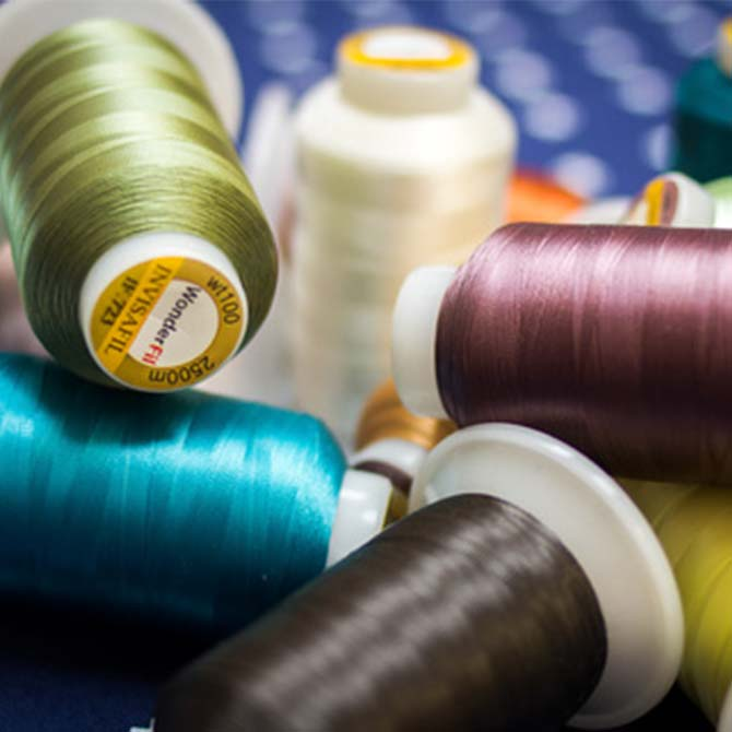 InvisaFil, cottonized soft polyester, 100wt - 2 ply by WonderFil Threads