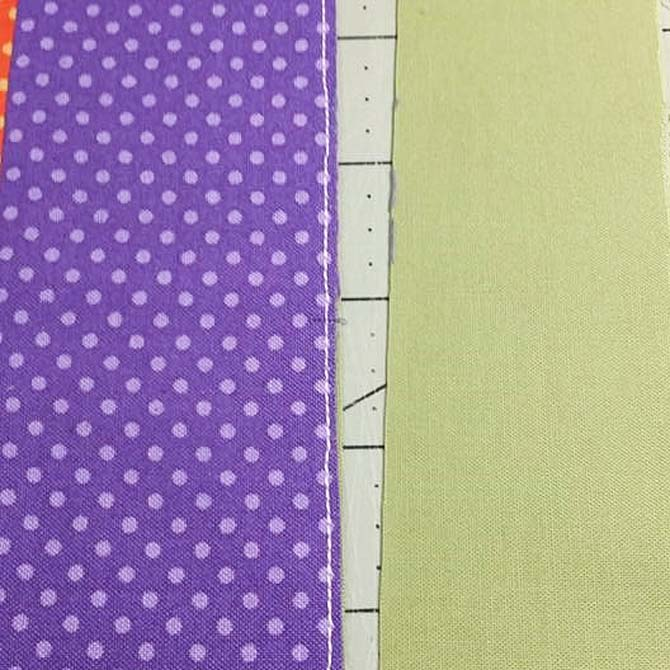 The excess backing fabric is trimmed from the panel made with the Urban Elementz Basix fabric strips.