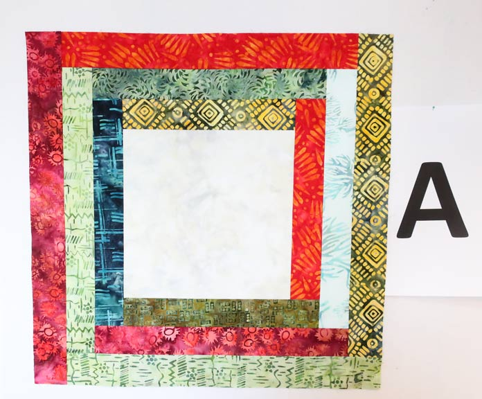 Multiple fabrics used randomly to create a colorful log cabin block.