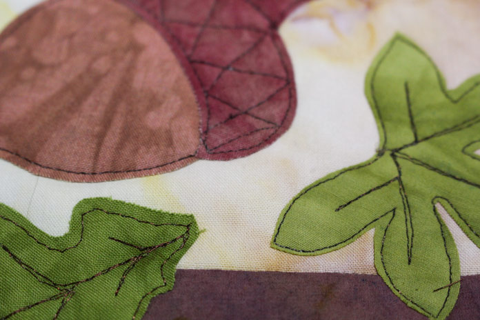 Raw edge applique on acorn and leaves