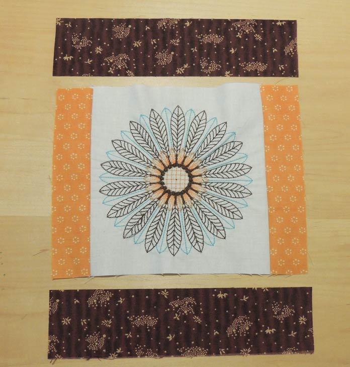 Adding fabrics to create courthouse step block.