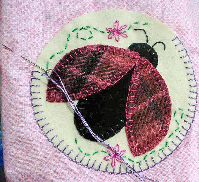 adding the wool appliques