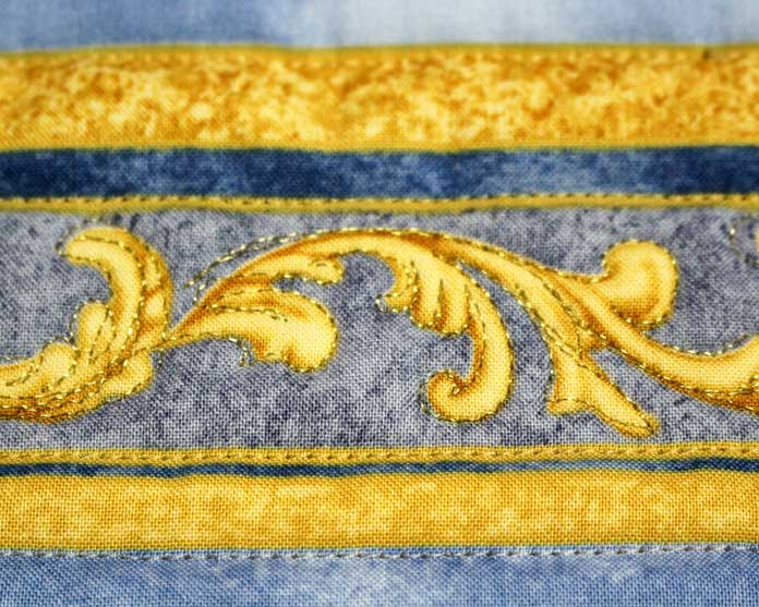 Stitch over the printed design on a panel to create sparkle.