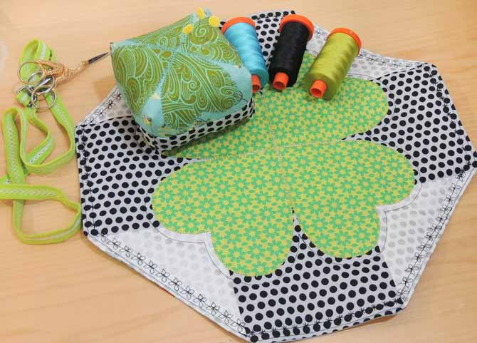 The finished lucky table topper features decorative stitches made with the PFAFF passport 3.0.