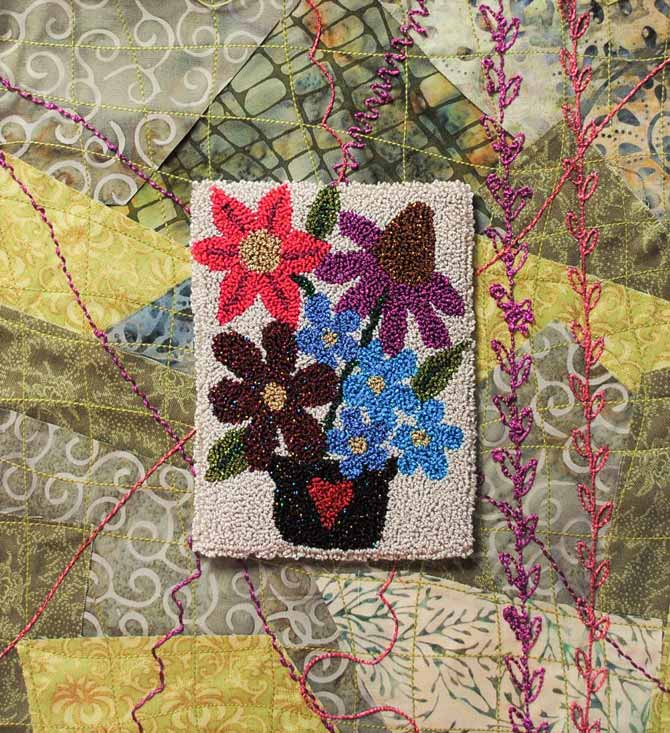 The Razzle and Dazzle punchneedle embroidery can be appliqued to fabric.
