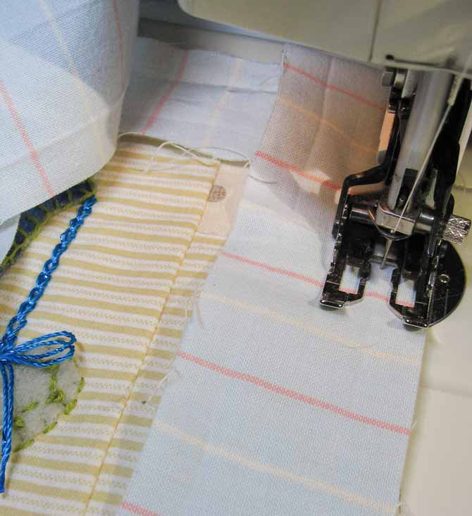 Binding strip sewn to the front of the mini quilt with the sewing machine's walking foot. WonderFil Specialty Threads.