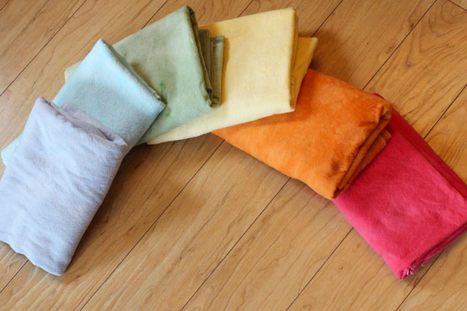 A rainbow of hand dyed receiving blankets using Dylon Permanent Fabric Dyes in China Blue, Bahama Blue, Tropical Green, Sunflower Yellow, Goldfish Orange and Tulip Red.