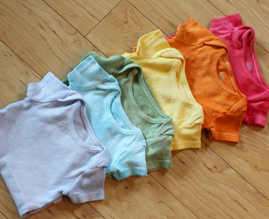 A rainbow of hand dyed onesies using Dylon Permanent Fabric Dyes in China Blue, Bahama Blue, Tropical Green, Sunflower Yellow, Goldfish Orange and Tulip Red.