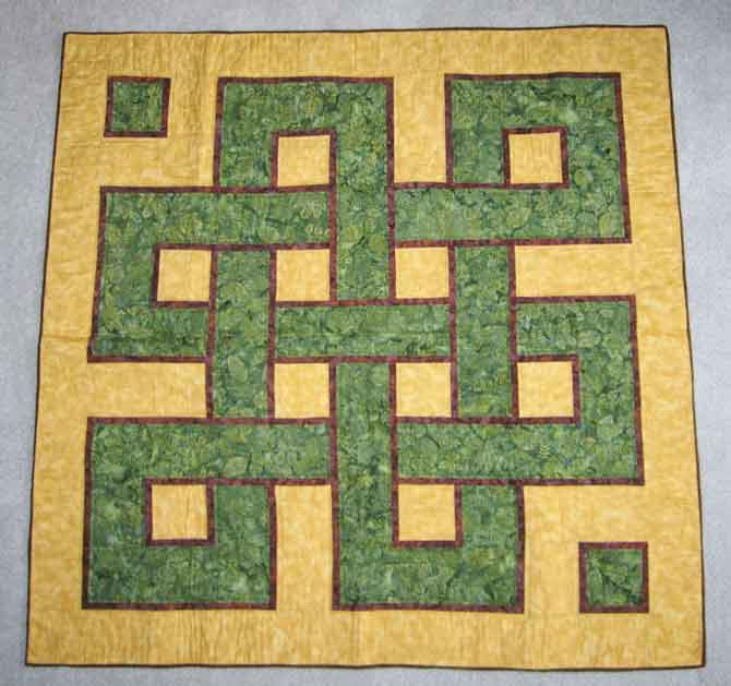 Around the Block quilt inspired by the book: Geometric Patterns & Borders, by David Wade (A non-quilting book)