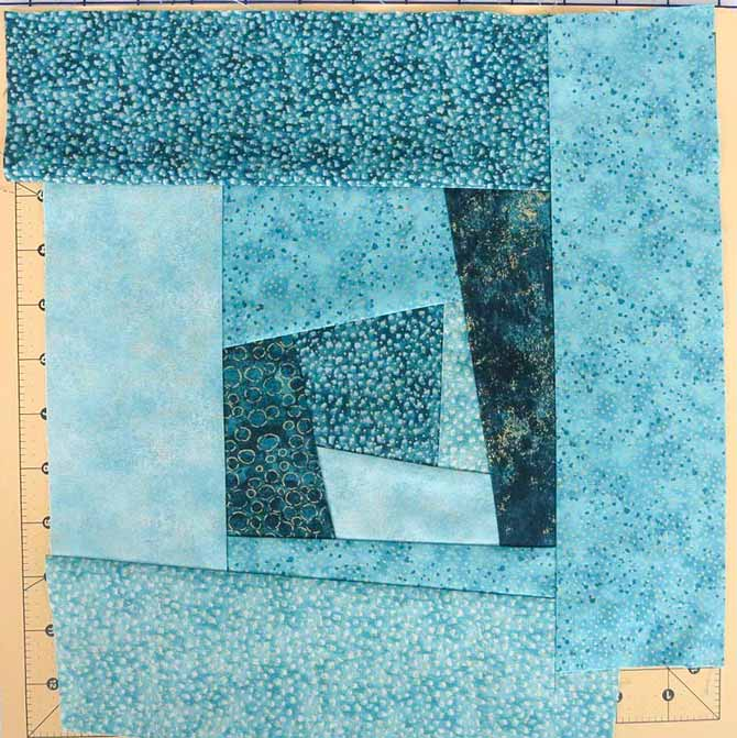 Sew on another round of strips of Northcott's Artisan Spirit fabrics to make the block the size you need.