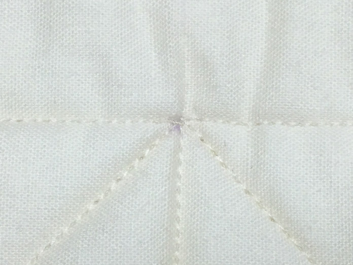 A short stitch length can be used to anchor the stitching.